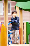 Boy  on playground Stock Images