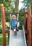 Boy at playground. Little blond boy on an outdoor playground Royalty Free Stock Images