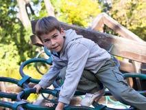 Boy at the playground Stock Photos