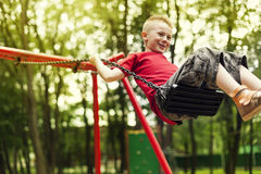Boy on playground Stock Photos