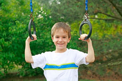 Boy at the Playground. Boy Having Fun Playing at the Playground Royalty Free Stock Images