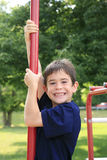 Boy at the Playground. Boy Having Fun Playing at the Playground Royalty Free Stock Image