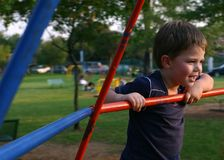 Boy at playground. Young boy at playground on roundabout royalty free stock photos