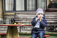 Boy. On the playground closely watching Stock Photography