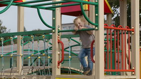 Boy on playground equipment. stock video footage