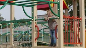 Boy on playground equipment. stock video footage