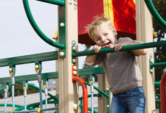 Boy on playground equipment. Royalty Free Stock Image