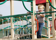 Boy on playground equipment. Royalty Free Stock Images