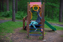 Boy at the playground Royalty Free Stock Image