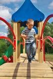 Boy on playground Stock Photography