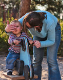 Boy on Playground with Mother stock images
