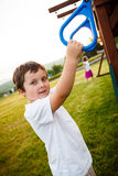 Boy in a playground. Boy at the rings in a playground Royalty Free Stock Photo