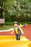 Boy on the playground slide Stock Images