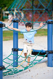 Boy on a playground swing Royalty Free Stock Image