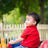 Boy on playground toy Stock Photography