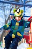 Boy on the playground in winter Royalty Free Stock Photo