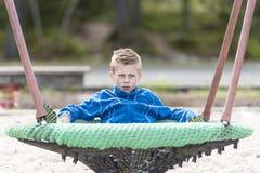 Boy at a playground Stock Photos