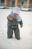 Boy playin in snow Stock Photos