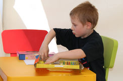 Boy Playing. With art supplies royalty free stock photo