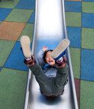 Boy Playing on slide Royalty Free Stock Photography