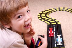 Boy playing. Little boy playing with toy car Stock Photos