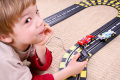 Boy playing. Little boy playing with toy car Royalty Free Stock Photo