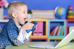 Boy Playing A Computer Game Royalty Free Stock Photography