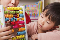 Boy Playing with Abacus Stock Photo