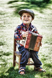 Boy playing accordion Stock Image