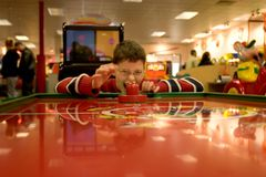 Boy Playing Air Hockey Stock Photos