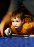 Boy playing air hockey Stock Photo