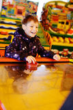 Boy playing air hockey game Royalty Free Stock Photos