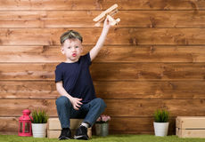 Boy playing with a airplane Royalty Free Stock Photo