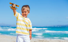 Boy playing with airplane Royalty Free Stock Photography
