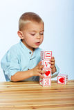 Boy playing with alphabet blocks Stock Photos