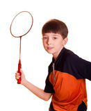 Boy playing badminton. Cute boy playing badminton isolated on white royalty free stock photography