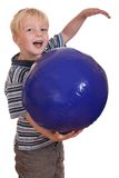 Boy playing with a ball Stock Photo