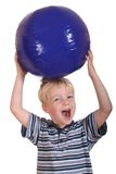 Boy playing with a ball Royalty Free Stock Image