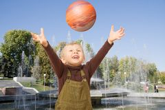Boy playing with ball Stock Images