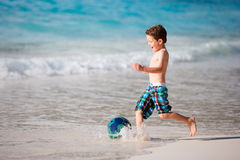 Boy playing with ball on beach Stock Photography