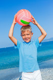 Boy playing ball at the beach Stock Photo