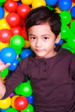 Boy playing in ball land Royalty Free Stock Photo