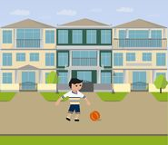 The boy is playing ball near the house Stock Photography