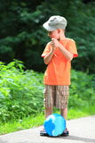 Boy playing with ball in park outdoors Stock Image