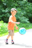 Boy playing with ball in park outdoors Royalty Free Stock Image