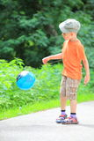 Boy playing with ball in park outdoors Royalty Free Stock Photo