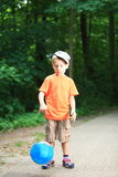 Boy playing with ball in park outdoors Royalty Free Stock Photos