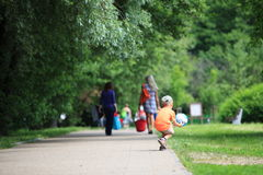 Boy playing with ball in park outdoors Royalty Free Stock Images