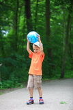 Boy playing with ball in park outdoors Royalty Free Stock Photography