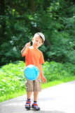 Boy playing with ball in park outdoors Stock Photography